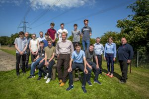 Horizon's Operations Director, Greg Evans, and the students at the proposed Wylfa Newydd site