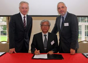 Professor John Hughes (Vice Chancellor of Bangor University), Kumiaki Moryia (Corporate Chief Engineer at Hitachi-GE Nuclear Energy Ltd.), Dr Michael Bluck, (Director of the Centre for Nuclear Engineering at Imperial College London) signing their MOU