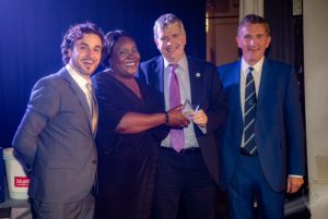Adrian Bull collecting his award (L-R): Patrick Monahan (the celebrity after-dinner speaker), Monica Mwanje (Chair of the NI NW Branch), Adrian Bull, Neil Thompson (President of the NI) ©Mick Ryan Photography